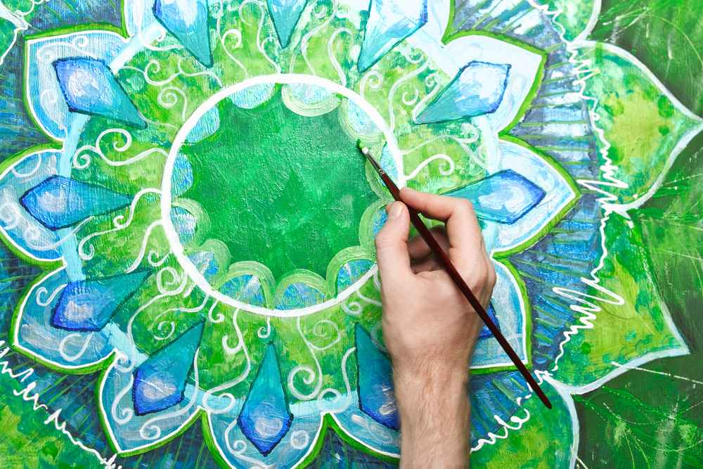 male-hand-painting-mandala2.jpg